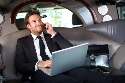 man in phone call with laptop